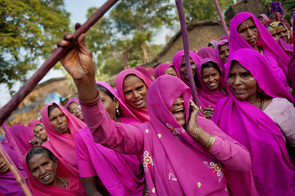 """A Gulabi Gang's member is preparing herself for a fight.  The Gulabi gang, or """"the pink gang"""" as in direct translation from Hindi, is a group of women who basically take justice in their own hands. Out of desperation in the government officials' incompetency in dealing with abusive and domestic violence, Sampat Pal Devi forms the Gulabi Gang. Its main purpose is to help promote better living conditions for women around India. After being in operation for more than half a decade, the Gulabi Gang is reported to have more than 20,000 members and has saved thousands of women's lives across the country."""