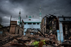 In a Muslim neighborhood, the mosque was the only building that survived after waves of violence led against Muslims by Buddhists have destroyed and left many buildings in ruins during the riots of March 2013 in the last Muslim quarter of the city Mektila. The violence escalated after a brawling at a gold shop.  The waves of anti-muslim violence paralyzes Myanmar and threatens the democratisation of the country. Whilst the historic reforms of president Thein Sein are being praised by the outside world many people are in shock. How is it that Buddhists who are well known for their humanism and pacifism, bear responsibility for the most brutal massacres and persecutions?  In this extensive story we meet Burmese Muslims who struggle for their lives in Bangkok, the Rohingya IDP-camps of Myanmar's Rakhine state and in the cities of Meiktila and Mandalay. They all bear the same questions - why are they being attacked and killed? What has triggered this primitive hate and violence towards the Muslim community in Myanmar? In our search for answers we also meet the notorious monk Wirathu in Mandalay; founder of the widely criticized anti-Muslim movement Campaign 969.