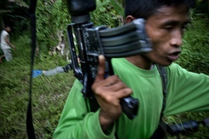 """""""Dont run with your weapon like in the movies, how are you going to fire with one hand"""", shouts the commander as one of the new recruits to the New Peoples Army (NPA) passes him."""