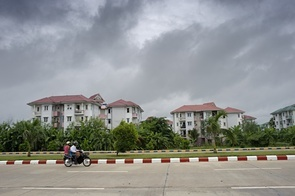 A newly built residential area in Naypyidaw. In great secrecy, Burma's ruling military junta started to build a city in the middle of a jungle. In 2005 it was proclaimed the new capital, named Naypyidaw. Thousands of government employees were given three days to move there. Now an empty parliament building awaits the first, in twenty years, parliamentary elections in Burma. Officially, it shall make Burma into a civilian-controlled democracy, but it is considered to be rigged to the military's advantage. The thousands of dissidents that like Aung San Suu Kyi, who is in prison or house arrest, are prohibited from standing for election. In the new capital there is no signs of the military loosening its grip on power.