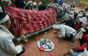 A tribal man prays in front of the coffin of Quang Van Xom, a 108-year-old man of Thai ethnic minority group in Chieng Ha commune in Vietnam's northern province of Son La. The Thais, with a population of around 1 million people, possess a diverse culture based on their own language and are among the 54 ethnic groups in the Southeast Asian country. Chieng Ha commune residents will soon have to be relocated, giving way for the reservoir construction of the $2.3 billion Son La plant, Vietnam's biggest hydro-power project.