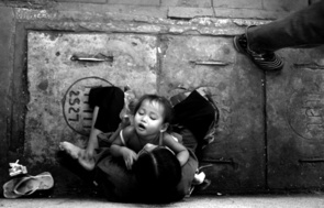 First Place - By Matthew Duncan: Many Bangkok children beg with their mothers – or women who claim to be their mothers. A child from a poor family can be hired for $50 a month to work as a beggar.