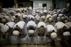 Narathiwat, Thailand April 24 2006: Ethnic tensions continue to claim lives in southern Thailand. Muslim children attend evening prayers at an Islamic school, or Pondoh, near the town of Narathiwat.