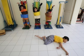 Standing therapy with supports helps straightena child's bones.