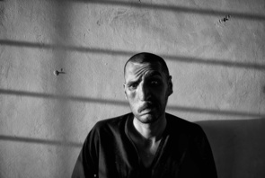 """Photographer of the Year - Paula Bronstein. A former drug addict at the Nejat rehabilitation program is traumatized, going through the early stages of the detox program. This story takes an in depth look at heroin story shot in Kabul from both the addiction side to the rehabilitation and detox. Afghanistan is the world's biggest producer of opium, the raw material of heroin, most of it grown in the southern provinces of Kandahar and Helmand, where it helps fund an increasingly vicious Taliban insurgency. The illicit industry has an estimated value of around three billion dollars a year, accounting for more than 90 per cent of the world's heroin supply. Obama's US special envoy for Pakistan and Afghanistan, Richard Holbrooke stated that the US counter-narcotics effort in Afghanistan """"may be the single most ineffective program in the history of foreign policy."""" A US Department of State report in 2009 stated that there are an estimated two million drug users in the country with at least 50-60,000 drug addicts in Kabul alone. Heroin addicts are on the increase in Kabul as the numbers of unemployed increase and the drug continues to be readily available and extremely cheap at only one dollar a hit."""