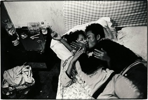 """Marriage by Force in China: Burma's Trafficking Victims. This Burmese woman was a victim of trafficking before being freed in Jie Gao, China. She is shown with her Burmese husband, who told her that if she would get pregnant, she could forget the tragedy. Last year Chinese police freed 268 Burmese women who had been trafficked and forced into marriages with Chinese men. Human rights activists believe this is a small fraction of the victims. Seeking to escape Burma's military regime, young women are often lured by recruiters who speak of well-paid employment in the world's fastest-growing economy. Beijing's """"one child policy"""" and a long-held national preference for male heirs has resulted in a lopsided male to female ratio. The shortage of potential brides drives many lonely Chinese men to buying a foreign spouse. A Chinese buyer will typically pay between 40,000 to 50,000 yuan (USD$6,000- $7,500). The new bride is forced to do house work or farming and is watched by her husband or his family at all times. Those who have escaped, tell of rape, physical abuse and loneliness. (Photo by Katsuo Takahashi)"""