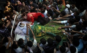 Sister of Feroz Ahmad alias Showkat wails as she clings to the bed carrying the body of her brother, killed by forces, during his funeral in Pattan some 35 kms north of Srinagar, India, Monday, Sept. 6, 2010.