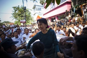 Aung San Suu Kyi arrives at her National League for Democracy (NLD) headquarters on November 14, 2010 in Yangon, Burma. Myanmar's pro-democracy leader Aung San Suu Kyi had been held under house arrest for the majority of the past 15 years but has now finally been released by the country's military leaders. After the first elections in 20 years the military backed Union Solidarity and Development Party (USDP) is reported to have won the election. (Photo by Athit Perawongmetha/Getty Images)