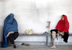 Two women missing legs  at the International Committee of the Red Cross (ICRC) Orthopaedic Centre in Kabul where victims of war as well as the disabled, are fitted with artificial limbs, hand made on the compound. Picture by Graham Crouch for The Australian Magazine