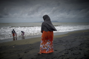A woman looks out to the sea on the North Coast of Banda Aceh where 10 years ago, a series of deadly tsunamis struck the province.   The tsunami of December 2004 was as deadly as the atomic bombs that were dropped on Hiroshima and Nagasaki together; but at the same time paved the way for peace in Indonesia. Inspired by Swedish social democracy, Aceh is now trying to build a functional society over the rubble left by the tsunami, however, the trauma left by the wave can still be seen 10 years later in many aspects of life. Many of those who survived the devastation were given compensation in the form of houses and aid from international organisations. However, there are still some families left in the former IDP refugee camps who have settled in permanently due to the promising of aid that never came. The tsunami did however, indirectly bring about peace and a new government as it ended the movement that started in 1976 to free Aceh, called the GAM rebellion against the central government in Jakarta. In the peace negotiations that followed the tsunami, Aceh was given regional autonomy, the first region in Indonesian allowed to set up local political parties and impose local laws. It remains forbidden to hoist GAM's former flag. Aceh is also believed to be one of the first regions in Indonesia to convert to Islam and have also introduced Sharia law and corporal punishment for multiple offenses.