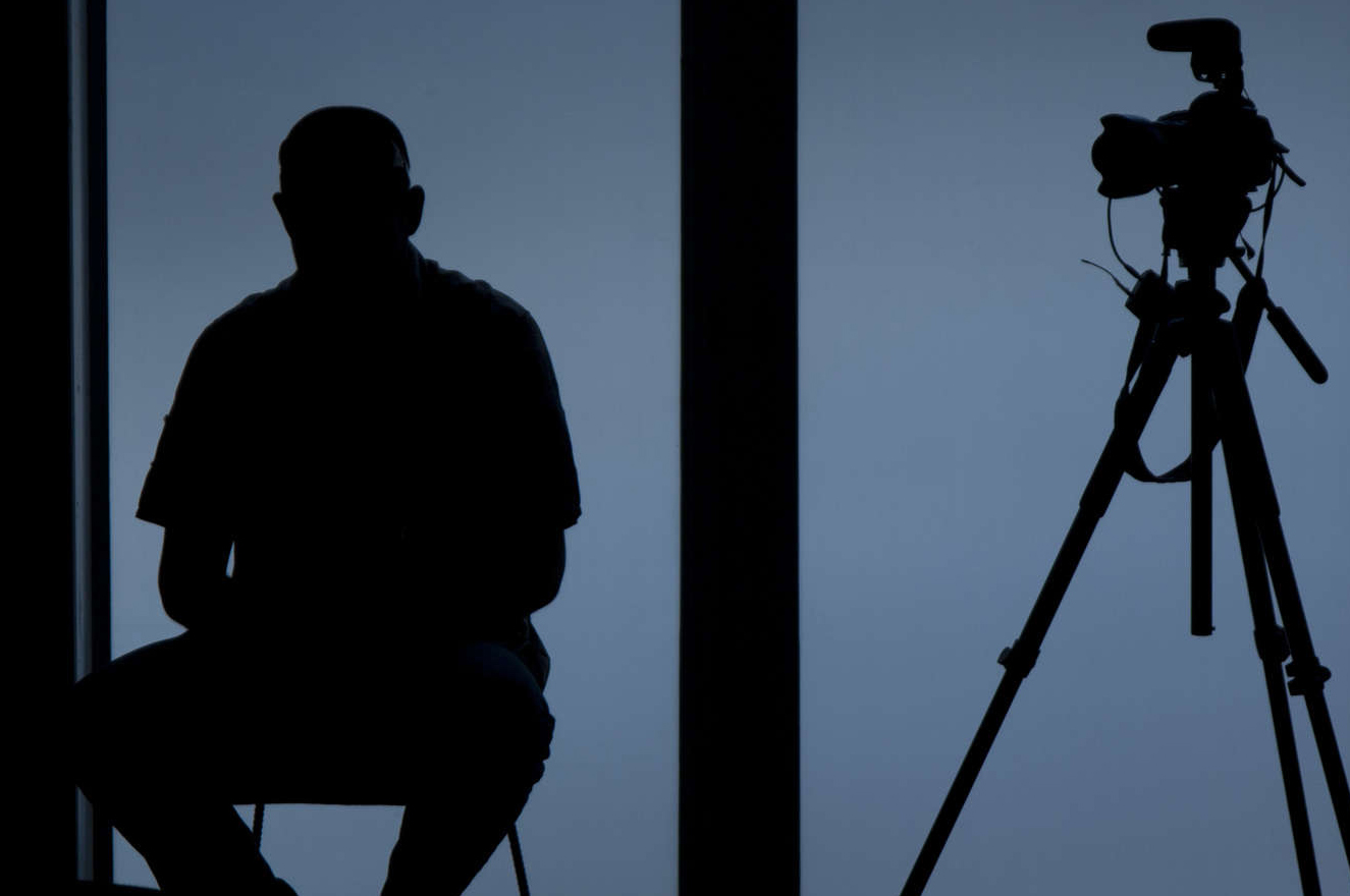 Silhouette of a photojournalist and his camera. LightRocket
