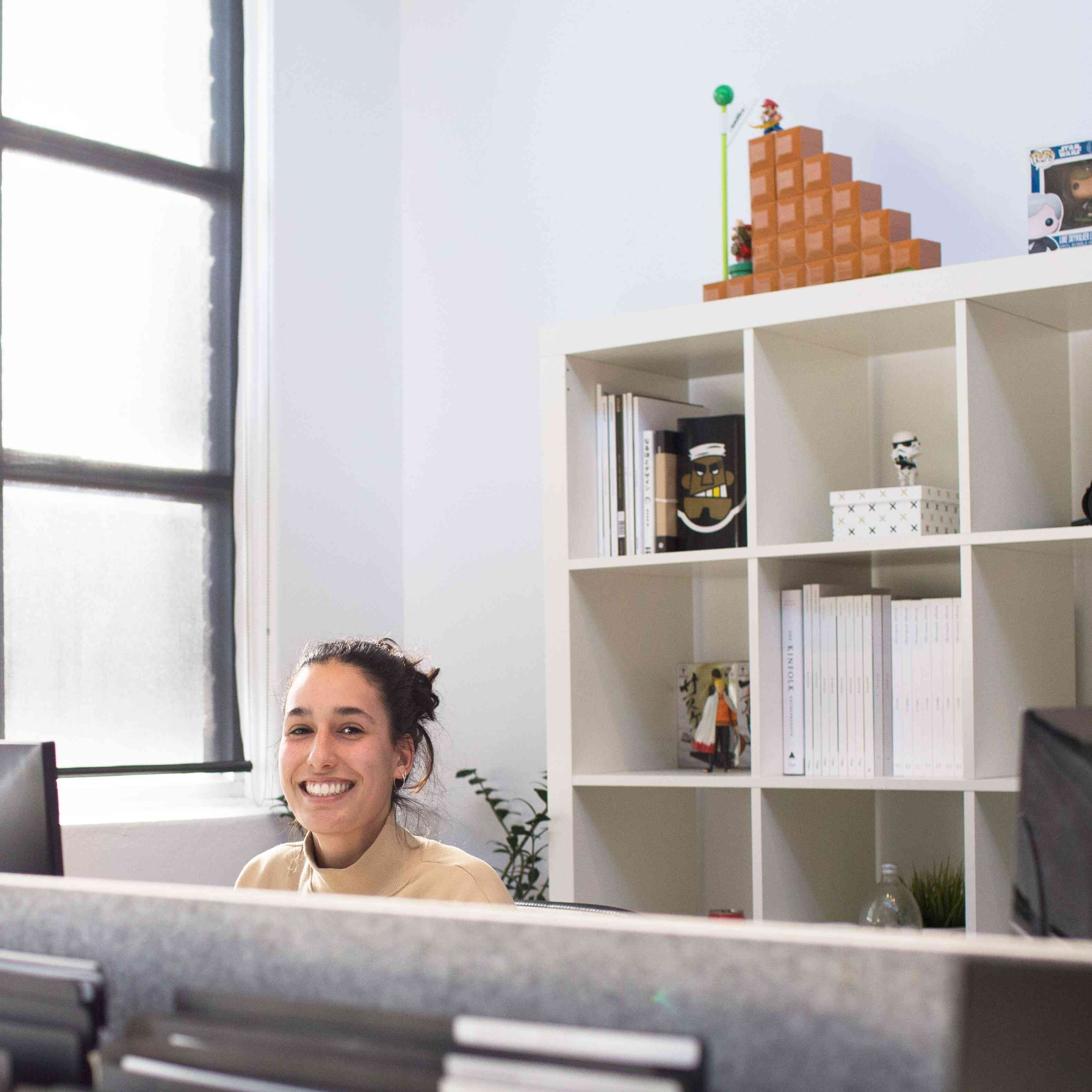 Smiling Woman Behind Computer