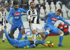 Juventus' forward from Argentina Gonzalo Higuain (C) fights for the ball with Napoli's Croatian midfielder Marko Rog (R, Napoli's Spanish defender Raul Albiol (L) and Napoli's French defender Kalidou Koulibaly (Down) during the first leg semifinal of Italy Cup football match Juventus FC vs SSC Napoli at the Juventus Stadium . Juventus FC won the match 3-1.