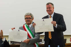 The mayor of New York city Bill de Blasio (C) receives the honorable citizenship in Grassano, Basilicata, southern Italy. Grassano is the village in southern Italy where grandmother of mayor of NYC was born. Bill de Blasio is in Grassano to receive the honorable citizenship.