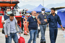 The Syrians Khaled Thaled (R) and Ahmad Dej (2nd L), stopped at Corigliano during disembarkation from ship Vos Hestia and arrested on May 31, 2017, following investigations by Eugenio Facciolla of the Prosecutor's Office of Castrovillari because they were accused of being boat drivers and traffickers of men who, together with their accomplices, ran a camp in Sabrata, Libya, where torture and violence took place. The prosecution supposes that they have traveled with the refugees to enter Europe