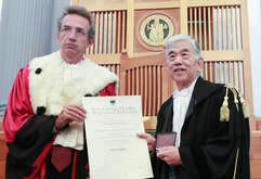 Rector Gaetano manfredi (L) gives an Honoris Causa Master degree in Engineering to Toray Industries inc.'s CEO Akihiro Nikkakuduring a ceremony in the University of Naples.
