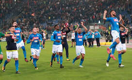 Napoli's players celebrate at the end of during the Italian Serie A football match AS Roma vs SSc Napoli at the Olimpico Stadium.  SSC Napoli won the match 1-0.