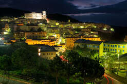 Night view of Corigliano Calabro, Calabria, southern Italy, with its castle dating back to the year 1000