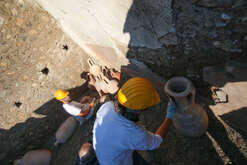 Restorers clean amphorae in the Schola Armatorarum, a house collapsed in 2010 where take place a new excavation campaign in the archaeological area of Pompeii, the ancient Roman town was buried in 79 AD by the eruption of the Vesuvius volcano.
