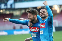 Napoli's Belgian striker Dries Mertens (L) celebrates after scoring a goal with teammate Napoli's Italian striker Lorenzo Insigne during the Italian Serie A football match SSC Napoli vs Bologna FC 1909 at the San Paolo Stadium. SSC Napoli won the match 3-1.