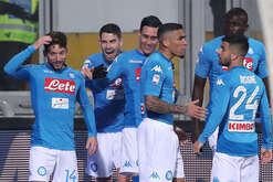 Napoli's Belgian striker Dries Mertens (L) celebrates after scoring with teammates during the Italian Serie A football match Benevento Calcio vs SSC Napoli on February 04 2018 at the Ciro Vigorito Stadium. SSC Napoli won the match 3-1