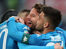 Napoli's Belgian striker Dries Mertens (C) celebrates after scoring during the Italian Serie A football match SSC Napoli vs SS Lazio on February 10 2018 at the San Paolo Stadium. SSC Napoli won the match 4-1.