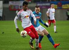 Leipzig's Brazilian midfielder Bernardo (L) fights for the ball with Napoli's Polish midfielder Piotr Zielinski during the Uefa Europa League round of 32 second leg football match RB Leipzig vs SSC Napoli on February 22 2018 at the Red Bull Arena. SSC Napoli won the match 2-0.