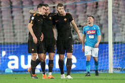 Roma's Bosnian striker Edin Dzeko (R) celebrates after scoring with teammates during the Italian Serie A football match SSC Napoli vs AS Roma on March 03 2018 at the San Paolo Stadium. AS Roma won the match 4-2.