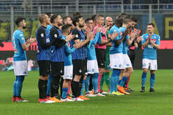 Inter's and napoli's players claps in tribute to the Fiorentina's captain Davide Astori dead at 31 on march 04, before the Italian Serie A football match FC Internazionale Milano vs SSC Napoli on March 11 2018 at the Giuseppe Meazza Stadium. The match ended 0-0.