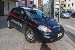 A car of the Carabinieri during a vast operation of the Carabinieri of the Provincial Command of Cosenza, which led to the arrest in Corigliano Calabro of 14 people for crimes of criminal association aimed at extortion, theft, stolen goods, and damage. Some of those arrested have precedents for mafia-type criminal association, 'ndrangheta.
