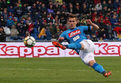 Napoli's Polish striker Arkadiusz Milik kicks the ball during the Italian Serie A football match US Sassuolo vs SSC Napoli on March 31 2018 at the Mapei Stadium. The match ended 1-1.