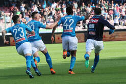Napoli's Guinean midfielder Amadou Diawara (2nd R) celebrates with teammates after scoring a goal during the Italian Serie A football match SSC Napoli vs AC Chievo Verona on April 08 2018 at the San Paolo Stadium. SSC Napoli won 2-1.