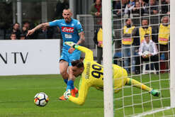 dMilan's Italian goalkeeper Gianluigi Donnarumma (R) dives after Napoli's Slovakian midfielder Marek Hamsik shooting the ball uring the Italian Serie A football match AC Milan vs SSC Napoli on April  15 2018 at the San Paolo Stadium.