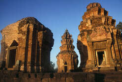 The 12th century Khmer temple of Prasat Sikhoraphum in Surin Province in the northeast of Thailand, a region known as Isaan. This imposing Khmer temple is one of the finest examples of Khmer architecture in the region as well as an elaborate replica of the home of the celestial gods. Above the doorways, it contains some particularly fine stone relief.