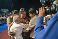 """Meoun Chrib (centre) is reunited with her mother Kont Lan (left) and her two sisters, Sa Lat (right) and So Pai (hidden on the left) during the Bayon TV channel programme """"It's not a dream"""" which helps people looking for relatives lost during the Khmer rouge regime in the late 1970s. Meoun Chrib has lost her mother and sisters in 1978."""