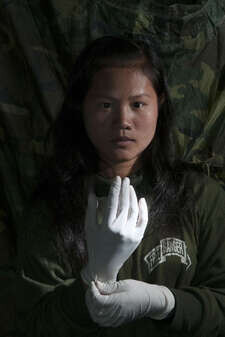 Naw Pel Htoo 19, an ethnic Pa-O nurse with the Free Burma Rangers (FBR). The FBR is a group constituted of volunteers from ethnic minorities that provides basic medical treatment, relief equipment and moral support to displaced and needy people in Burma's ethnic territories. The FBR relief teams are also trained in media reporting.