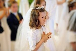 Girl receiving the sacrament of communion.
