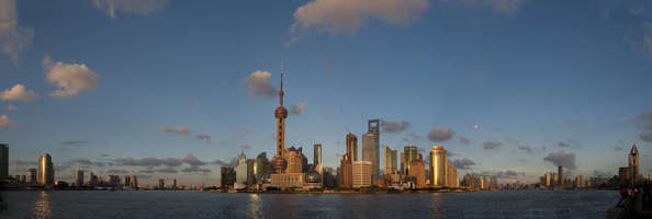 China, Shanghai, Panoramic View From Bund Of Pudong Skyline With Huangpu River, Oriental Pearl Television Tower And Shanghai World Financial Center.