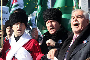 """Circassians which will be held in the Russian city of Sochi""""2014 Winter Olympics, the Circassian Genocide and Exile""""protested.  Circassians chant """"Sochi is a symbol of genocide""""."""