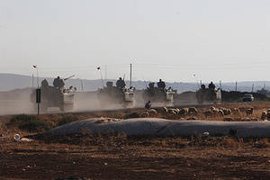 Oct 6, 2014 - Sanliurfa, Turkey - Turkish tanks deployed Syrian border due to stray mortar shells in Suruc, Sanliurfa. (Credit Image: ? Tumay Berkin/ZUMA Wire) Turkish tanks deploy along the Syrian border after mortar shells landed in the area in Suruc, Sanliurfa. Fighting continues to rage in the Syria-Turkey border town of Kobane, with Islamic State (IS) militants moving into a southern district. The US-led coalition has carried out more air strikes to try to aid the Syrian Kurd defenders. However, Turkish President Recep Tayyip Erdogan warned air strikes were not enough and Kobane was ''about to fall''. At least 400 people have died in three weeks of fighting for Kobane, monitors say, and 160,000 Syrians have fled.