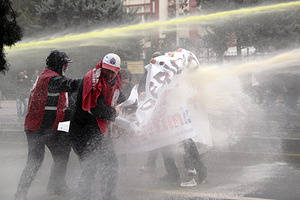 Turkish police used water cannons and tear gas to disperse teachers walking to Kizilay Square in Ankara for protest against AKP government's education policy.