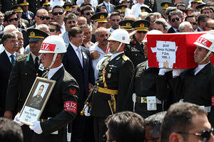Turkey's Prime Minister Ahmet Davutoglu, Chief Of Staff General Necdet Ozel and Turkish soldier Hamza Yildirim's father during a funeral ceremony in Ankara, Three Turkish troops were killed in armed terrorist attack in Sirnak on July 30, 2015.