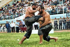 Two wrestlers compete during the 7th Turkish oil wrestling tournament held in Ankara.