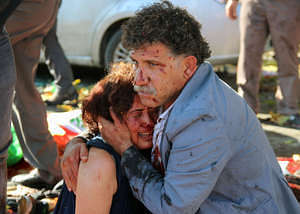 "An injured man hugs an injured woman after an explosion during a peace march in Ankara, Turkey, October 10, 2015. At least one explosion shook a road junction in the centre of the Turkish capital Ankara on Saturday, causing many casualties including fatalities, local media said. The state-run Anadolu Agency said there were reports that the blast was caused by a suicide bomber, but the source of those reports was unclear. The blast occurred ahead of a planned ""peace"" march to protest against the conflict between the state and Kurdish militants in southeast Turkey. Earlier media reports had said there were two explosions. REUTERS/Tumay Berkin"