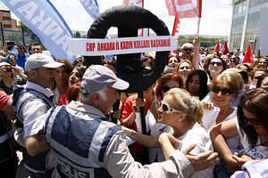 Female supporters of the Republican Peoples Party (CHP) protested the AKP governments policies against women. Police did not allow them to walk to the AKP headquarters in Ankara to present a black wreath.