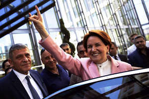 """Nationalist Movement Party (MHP)  Leader candidate Meral Aksener show the symbol of the Turkish nationalist """"wolf"""" at Press conference in Ankara."""